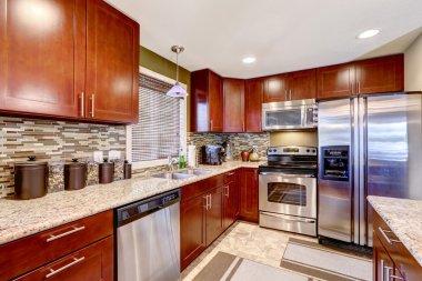 Modern kitchen interior with mosaic back splash trim and granite