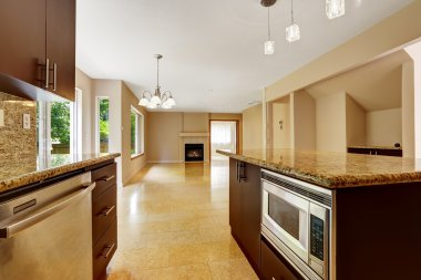 Empty house interior with kitchen area. Marble tile floor