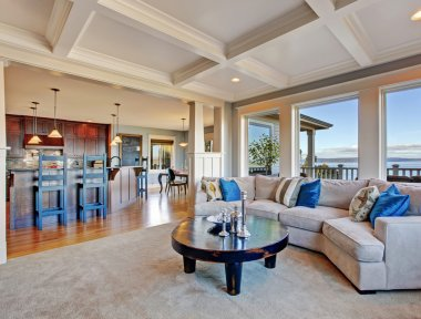 Luxury house with open floor plan. Coffered ceiling, carpet and