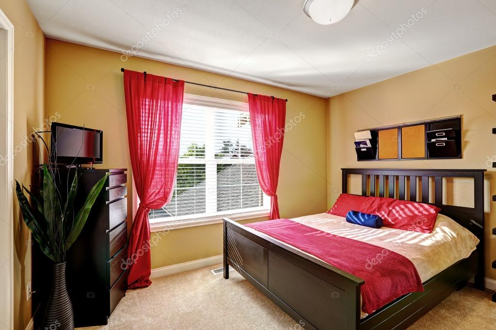 Simple Yet Practical Bedroom Design With Red Curtains Stock Photo 55826377