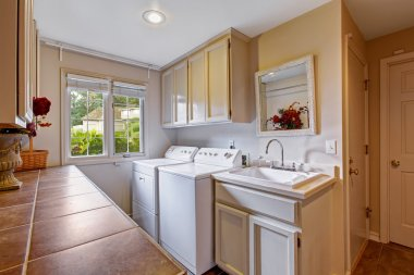 Laundry room with standard appliances