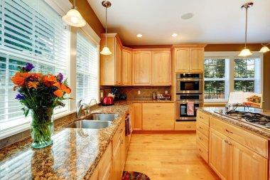 Kitchen maple storage combination with granite tops