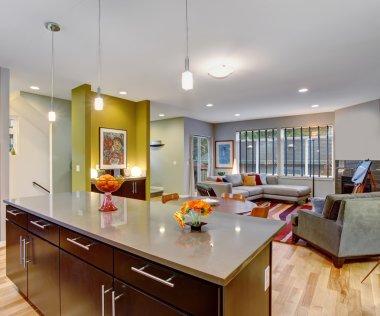 Retro kitchen with modern twist along with hardwood floor.