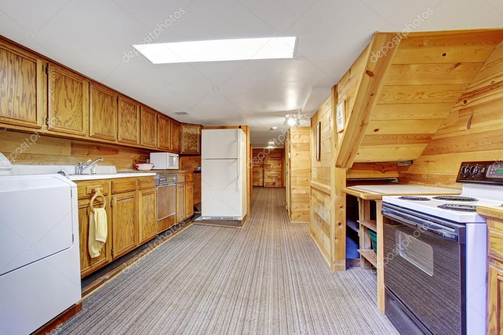 Authentic Kitchen Laundry Room Combo With Carpet.