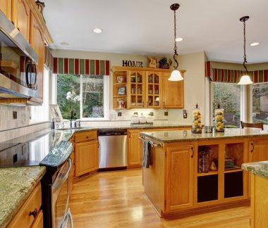 Astounding kitchen with hardwood floors, and marble counters.