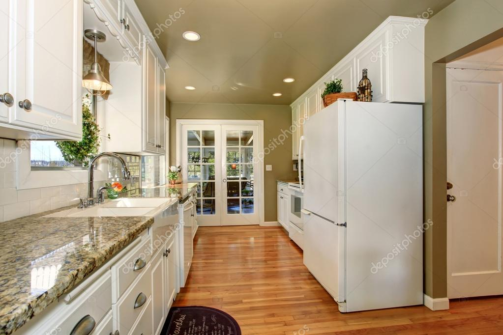 State Of The Art Kitchen With White Accents And Green Walls. U2014 Stock Photo #