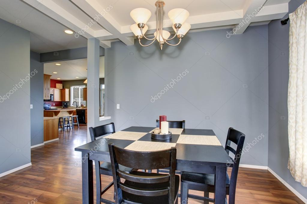 simplistic dinning room with gray walls.