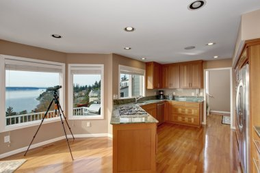wonderful kitchen with deep hardwood floor and marble counters.