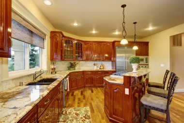Large luxury kitchen with marble counters.