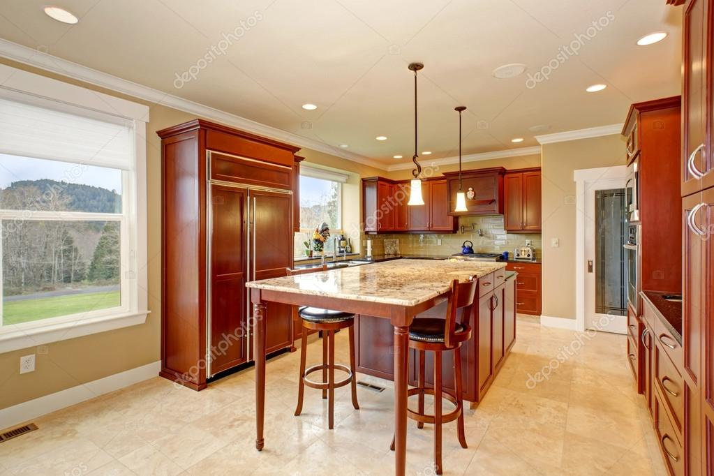 State Of The Art Kitchen With Tall Island. U2014 Stock Photo #79173356