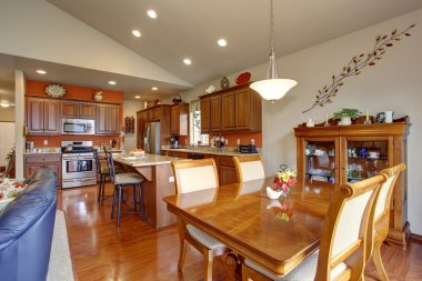 American traditional kitchen with glossy hardwood floor.