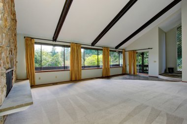 Lovely unfurnished living room with many windows.