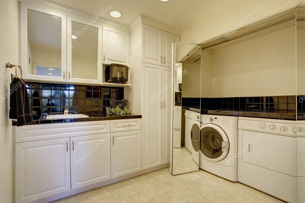 Laundry Room With Washer Dryer And Miror Folding Doors Royalty Free Stock Images