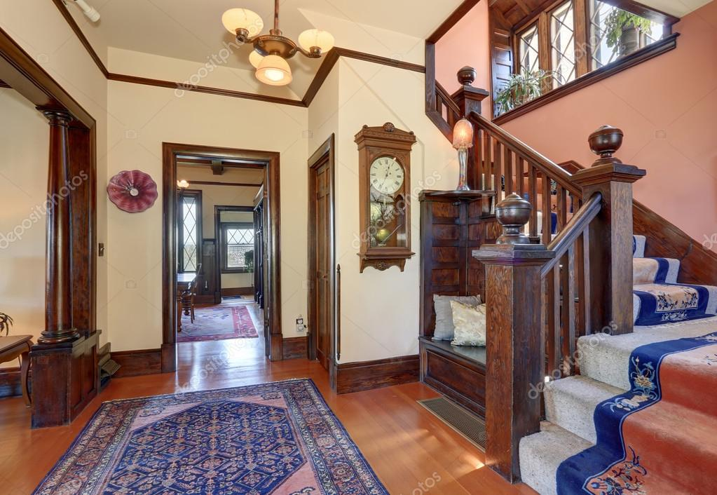 Elegant staircase with blue rugs.