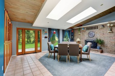 Large dinning area with blue run and tile floor.