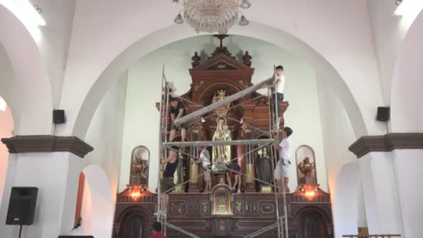 Catholic Christian cleaning the altar
