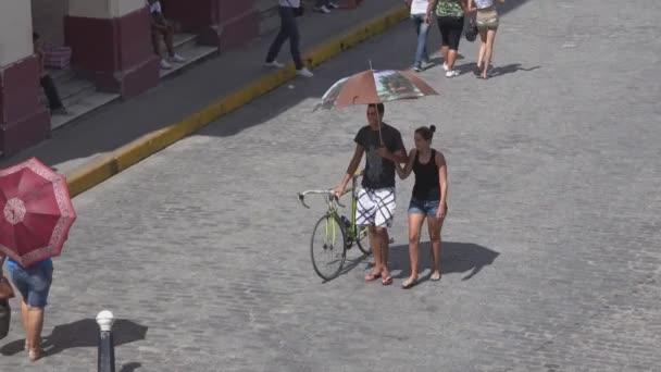 People walking in the main plaza in Santa Clara