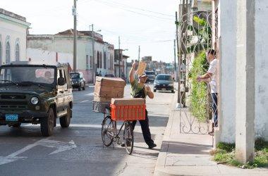 Reselling bread loaves by neighborhoods in Cuba