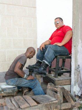 Shoe shiner or shoe shine person working