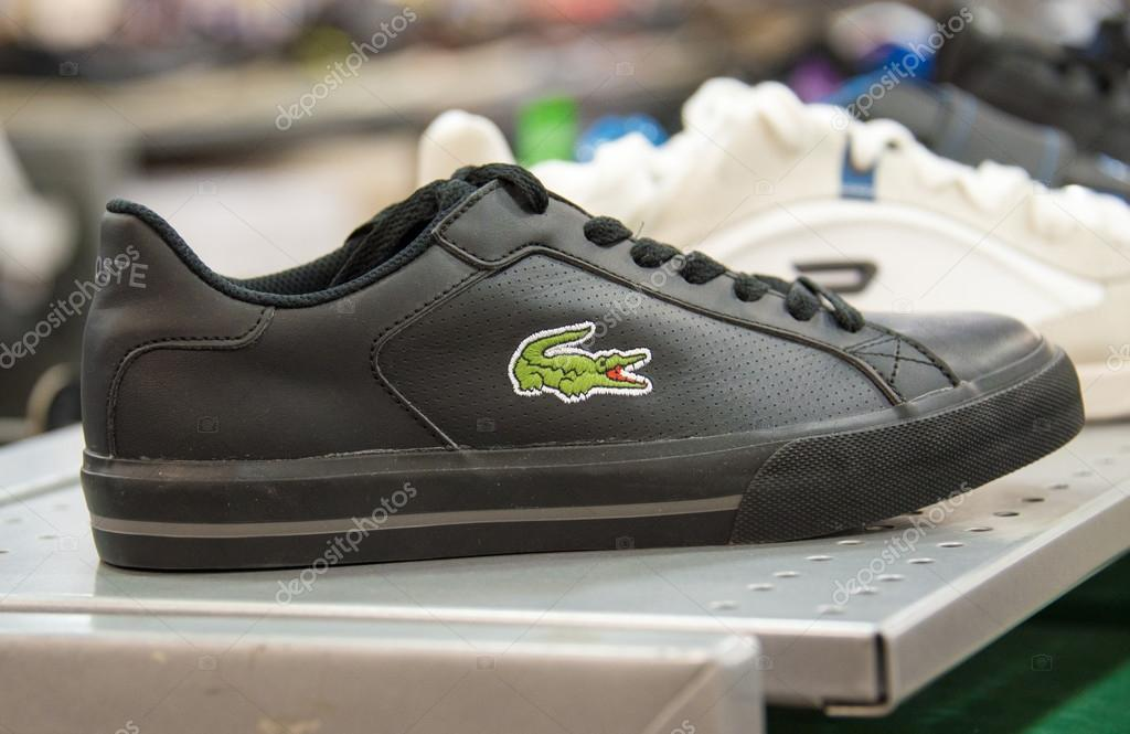 Lacoste Shoe in store shelf, Lacoste is a French clothing company founded  in 1933 that sells high-end clothing, footwear, perfume, leather goods,  watches, ... 973b748a005