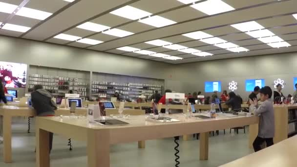 Time lapse of people buying new iphone inside Apple store