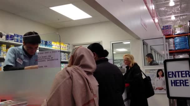 People taking medicine at pharmacy store