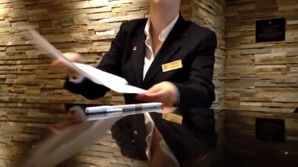 Receptionists making reservation for guest at Best Western Hotel.