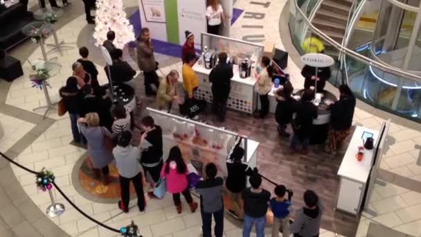 Top shot of people line up for free coffee inside shopping mall in Burnaby BC Canada.