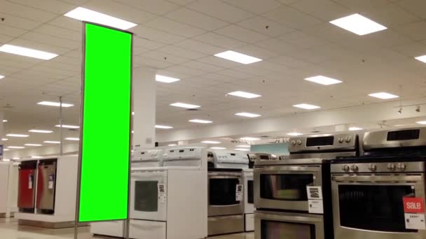 Green billboard for your ad beside large appliance inside Sears store