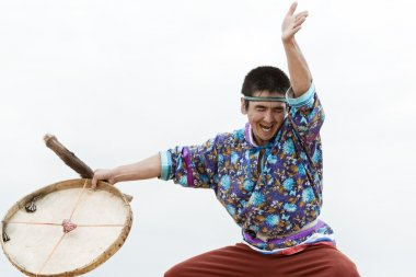 Expression man dancer dancing with a tambourine. Russia, Kamchatka