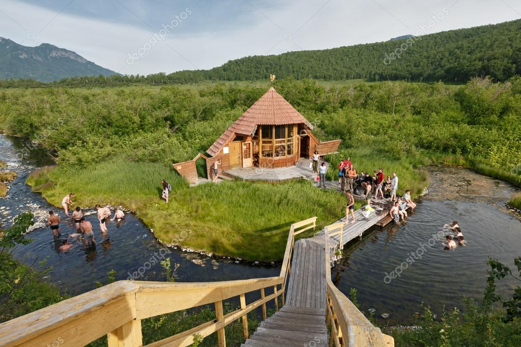 Tourists swimming in natural thermal pools. Russia, Far East, Kamchatka Peninsula