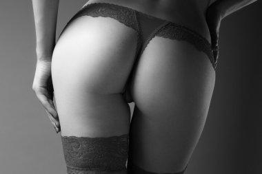Female body in red lace underwear