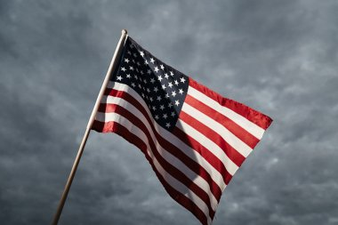 American flag on sky background