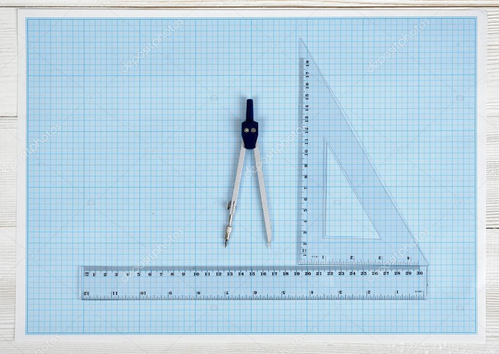 Centimeter rulers and engineering divider on a blueprint stock triangle centimeter ruler simple centimeter ruler and engineering divider on a blueprint top view composition measuring process work place of draftsman malvernweather Gallery