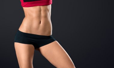 Woman with strong and perfect abs