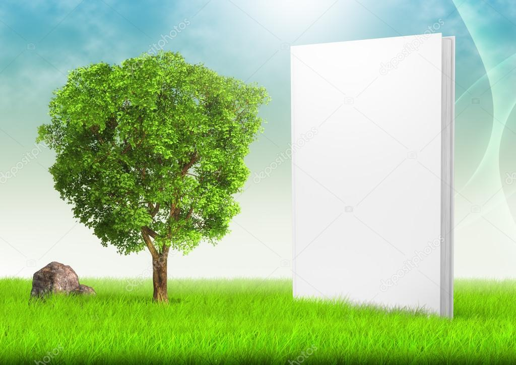 White book and tree in field of grass under blue sky