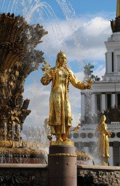 golden statue of Turkmen girls