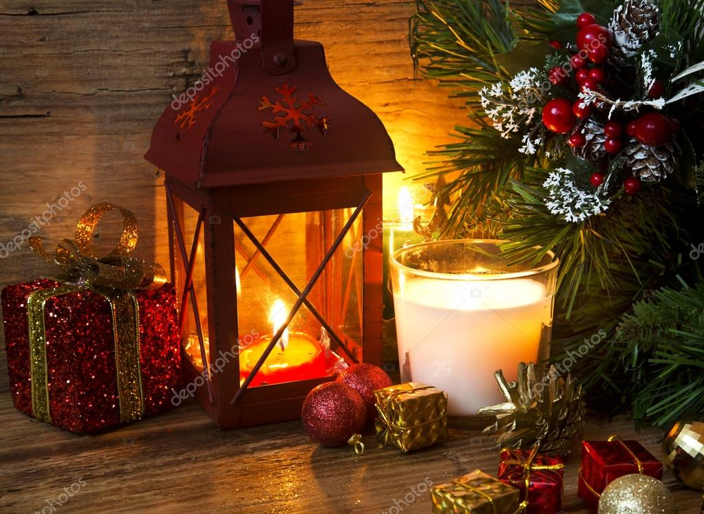 magic christmas lantern with candles and decorations stock photo