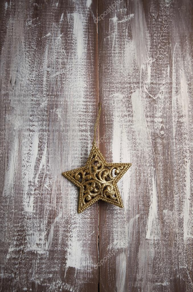 Golden Glitter Star Christmas Ornament On Wooden Painted Table Stock Photo