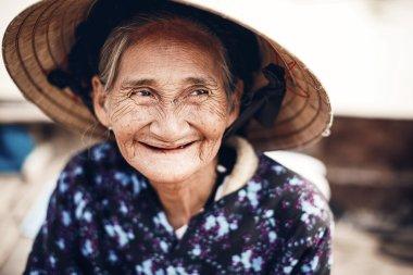 An unidentified Vietnamese woman smile