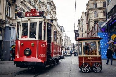 ISTANBUL, TURKEY - NOVEMBER 28: Old tram bagel truck at Istiklal Avenue in Istanbul, Turkey stock vector