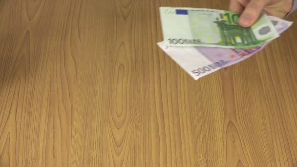 Woman hand pay euro cash 100 and 500 banknotes for man. 4K