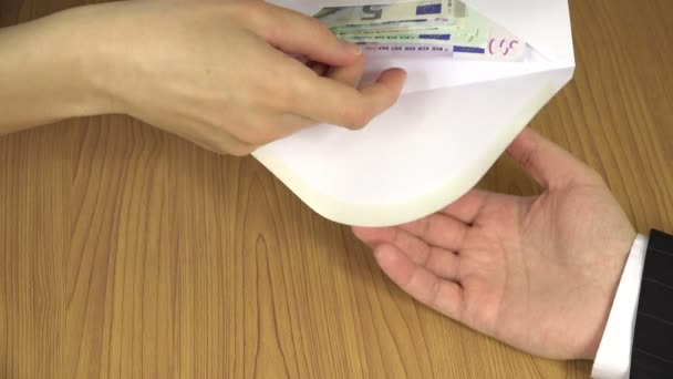 Woman hand give 500 euro cash banknote bribe from envelope. 4K