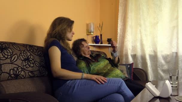 Pregnant granddaughter girl measure senior woman blood pressure