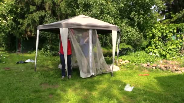 Father and son people attach protective tent bower net in garden Stock Video & Raindrops on green canvas tent in the rain. u2014 Stock Video ...