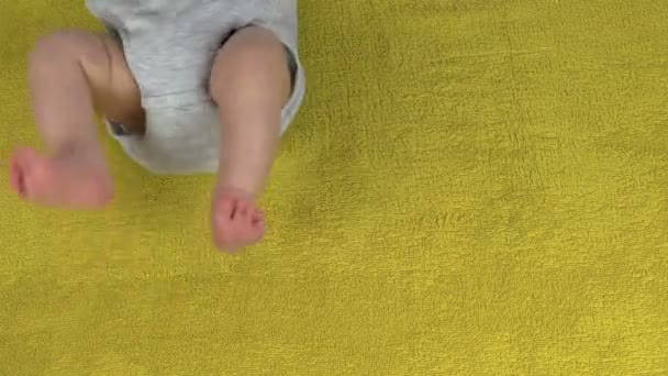 Mother put foot and palm mark near infant baby