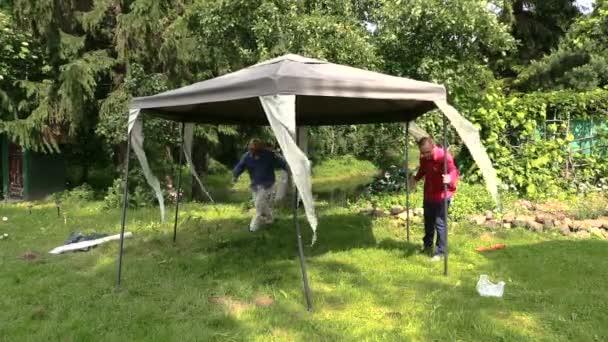 People fix garden tent bower long metal legs