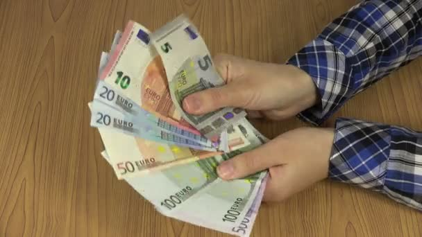 Hand hold euro money fan with different banknotes. 4K