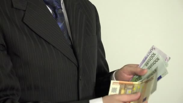 Successful salesman man in suit count money euro banknotes. 4K