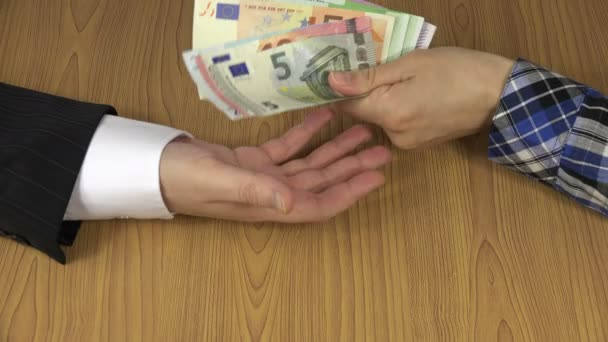 Woman hand pay dirty illegal euro cash banknote for man. 4K